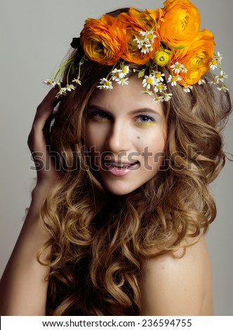 Beauty young woman with flowers and make up close up, real spring beauty girl curly hair