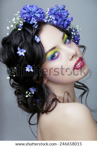 Beauty young woman with flowers and make up close up, real spring beauty girl floral