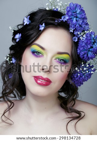Beauty young woman with flowers and make up closeup, real spring beauty girl floral summer