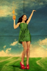 beauty young woman with orange juice, in green dress on sunny meadow