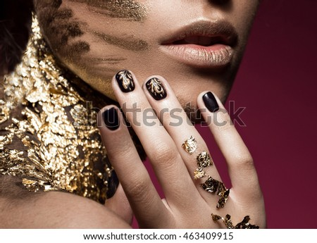 Beautyful girl with gold glitter on her face and design manicure. Art image beauty #463409915