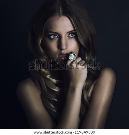 beautyful young woman portrait. jewerly and diamonds