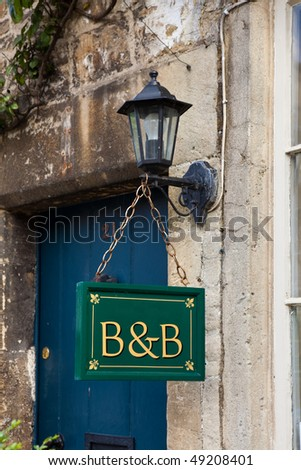 stock photo : Bed and Breakfast sign board in an English village
