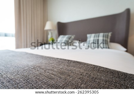 Bed and pillow set with bed runner. soft focus on bed runner. intended blur