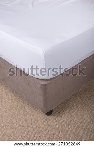 Bed corner with white sheet