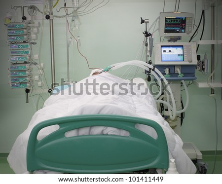 bed ICU with the patient. photo