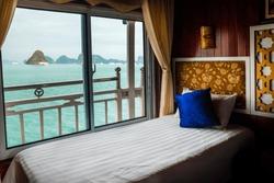 Bed in cruise ship cabin. Halong Bay, Vietnam.