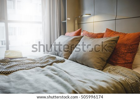 Bed maid-up with clean white pillows and bed sheets in beauty room. Close-up. Lens flair in sunlight. #505996174