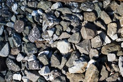 Bed of grey rocks on a trailway