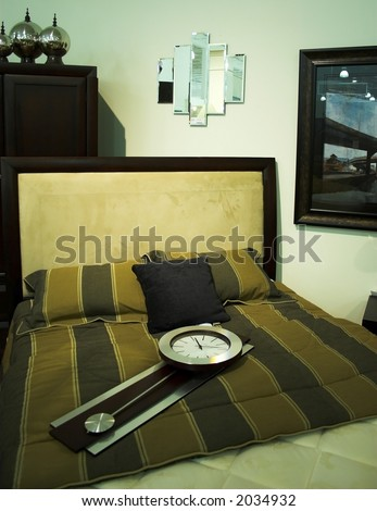 bed room set with CLOCK on the bed