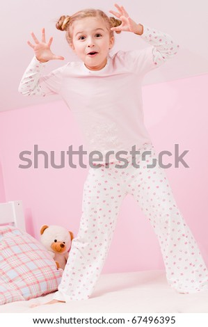 Bed time - little girl playing in bedroom (no name teddy bear)