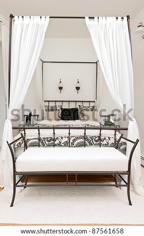 Bed with curtain in modern interior - stock photo