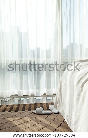 bed with first sunlight at morning - stock photo