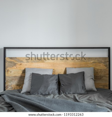 Bed with metal and wooden headboard, gray bedding #1193312263