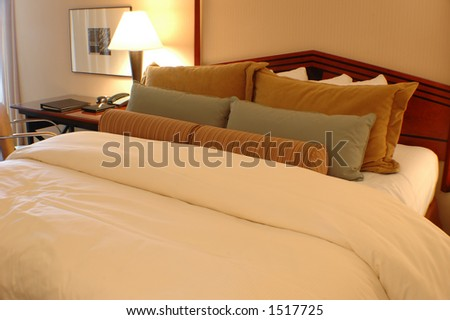 Bed with pillows and comforter in a hotel room