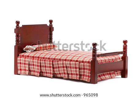 Bed with red cover isolated on white