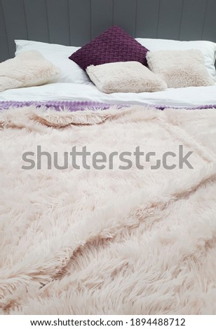 bed with soft fluffy light pink plaid and pillows Photo stock ©