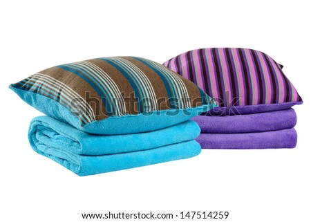Bedding objects. Soft pillow on folded blanket.