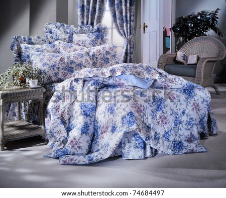 Bedding set shot in studio with window light and soft moody feel