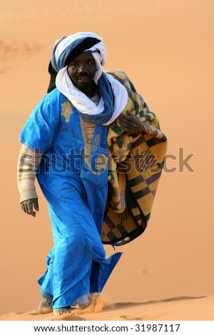 Bedouin in desert Sahara - stock photo