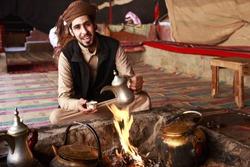 Bedouin man serving Arabic coffee in Wadi Rum,Jordan