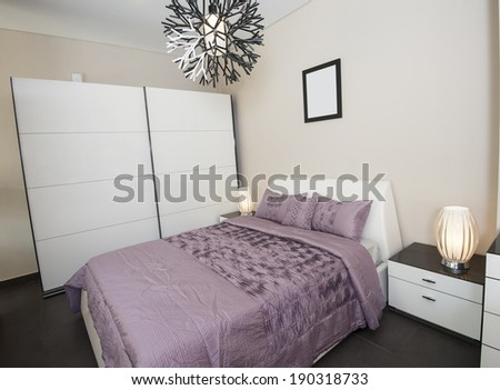 Bedroom area in show home with wardrobe and lamps #190318733