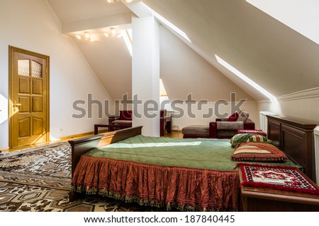 Bedroom attic interior with carpet and table