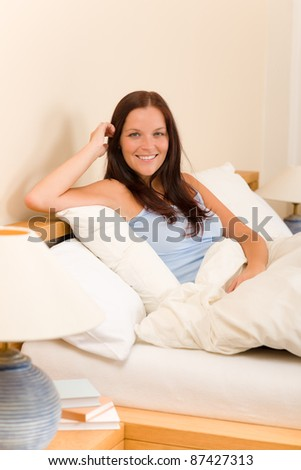 Bedroom - beautiful woman morning waking up sitting on white bed