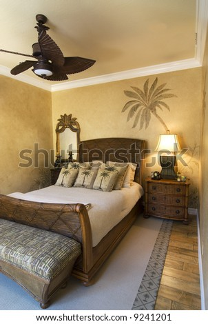 bedroom decorated in tropical style with ceiling fan