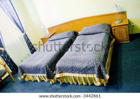 Bedroom in double room hotel, wide perspective