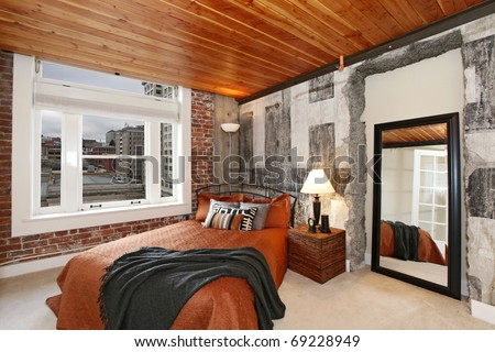 Bedroom in Modern City Apartment with wood ceiling and city view.