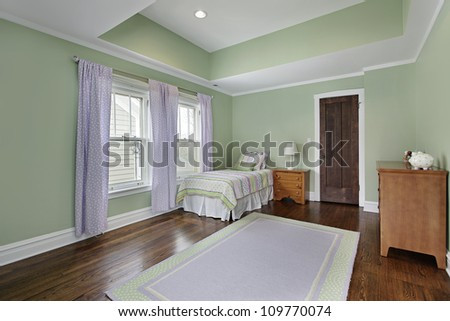 Bedroom in suburban home with green walls