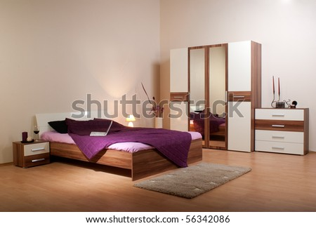 bedroom interior showcase including bed, wardrobe, bedside table commodes, linen-press