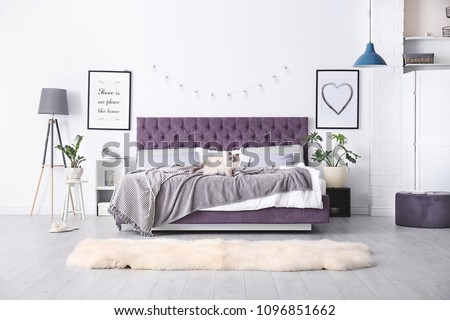 Bedroom interior with comfortable soft bed #1096851662