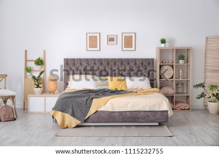Bedroom interior with comfortable soft bed #1115232755