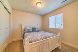 Bedroom interior with double bed window and flush mount dome ceiling light