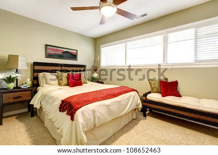 Bedroom interior with red and green, elegant simple design.