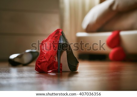 Bedroom mess with lingerie and shoes, quick sex concept