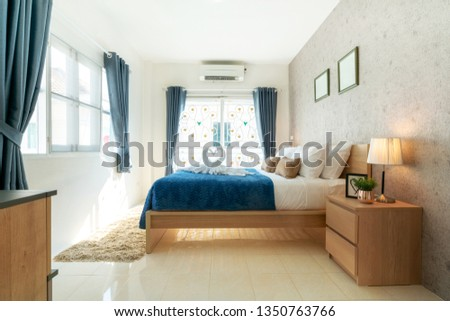 bedroom of the house or home with cozy bed , swan towel , high raised ceiling and blue blanket , interior design real estate  #1350763766