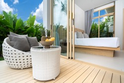 bedroom with balcony and green garden