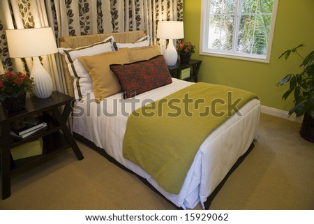 Bedroom with stylish furniture and decor.