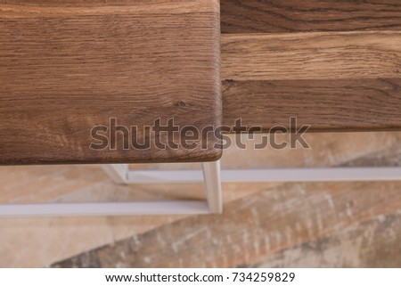 Bedside wooden table in loft style in a room of wood. #734259829