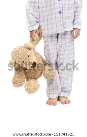 Bedtime - child in pajamas with teddy bear