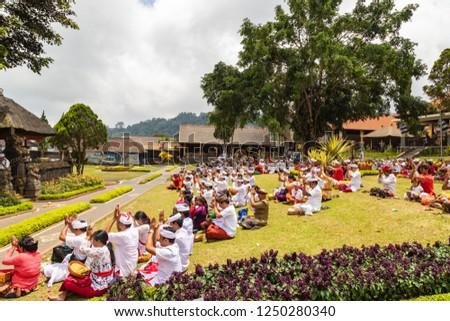 BEDUGUL/BALI,  INDONESIA - OCTOBER 27, 2018: Public prayer at Pura Ulun Danu Beratan #1250280340
