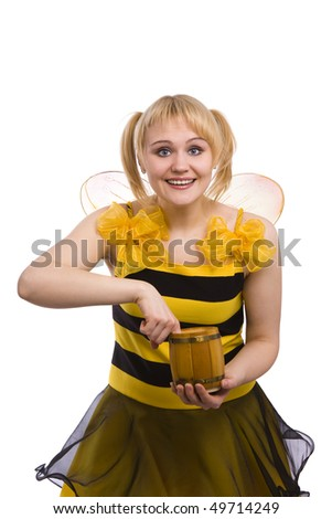 Bee costumes woman is eating honey. Woman wearing fancy dress on Halloween looking surprised. Cute girl in bee costume on white.