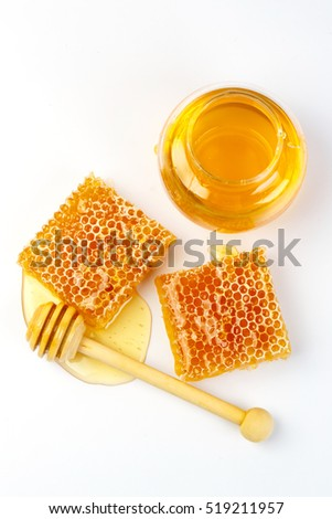 Bee products with honey, sweet honeycomb and dipper isolated on white background, healthy products by organic natural ingredients concept
