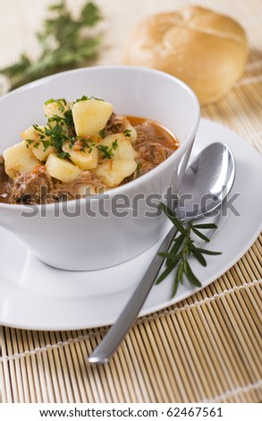 Beef and pork dish with bread roll