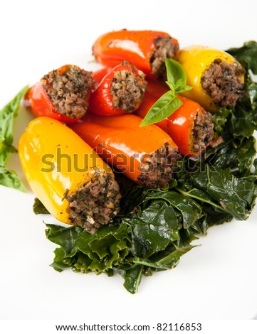 Beef and vegetables Stuffed Mini Bell Peppers Served on Wilted Kale