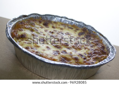 Beef baked lasagne with beshamel in takeaway silver foil