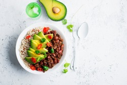 Beef beans bowl with brown rice and half avocado for a healthy diet. Top View